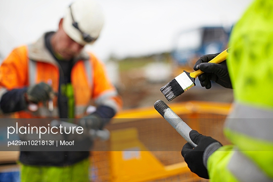 Engineers working at wind farm - p429m1021813f by Moof