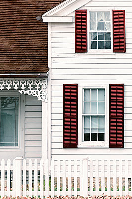 White Sided House with Picket Fence - p1331m1196425 by Margie Hurwich