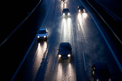 Cars on autobahn during rain - p30020242f by Florian Löbermann