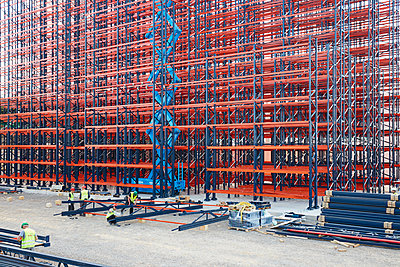 Constructing high rack storehouse - p719m1333194 by Rudi Sebastian