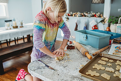 Girl kneading dough for cookies - p1166m2165855 by Cavan Images