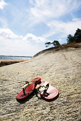 Sandals on a cliff in the archipelago Sweden. - p31221165f by Conny Fridh