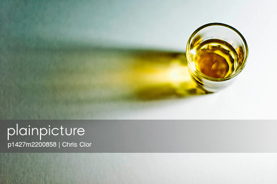 Whiskey in glass - p1427m2200858 by Chris Clor