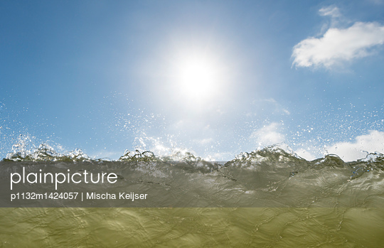 Water surface against the light - p1132m1424057 by Mischa Keijser
