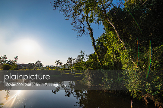 Sunrise over calm lake, Sihanoukville Province, Kampot, Cambodia - p924m2091248 by Henn Photography