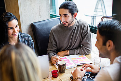 Young people in cafe - p312m1107482f by Susanne Walstrom