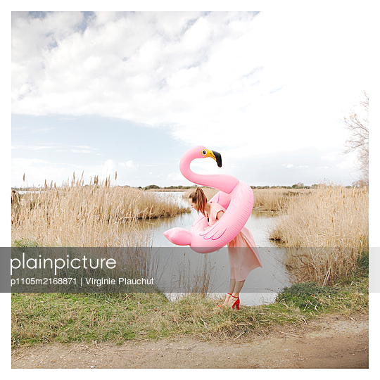 Woman with Pink flamingo - p1105m2168871 by Virginie Plauchut