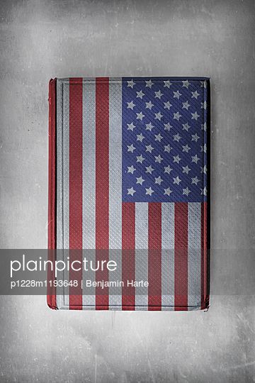 American flag on the cover of a book - p1228m1193648 by Benjamin Harte