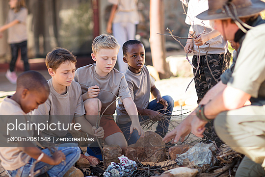 Children learning how to make a fire - p300m2081548 by zerocreatives