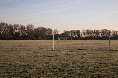 Two soccer goals on deserted football field - p1291m2181565 by Marcus Bastel