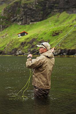 Man fishing - p312m2139278 by Hans Berggren