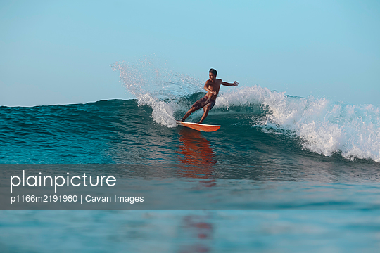 Surfer on a wave, Lombok, Indonesia - p1166m2191980 by Cavan Images