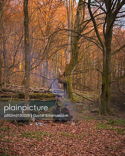 Men camping in forest - p352m2120228 by Gustaf Emanuelsson