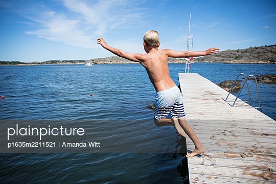jumping off the dock - p1635m2211521 by Amanda Witt