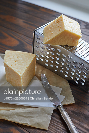 Västerbotten Hard cheese and grater - p1573m2260884 by Christian Bendel