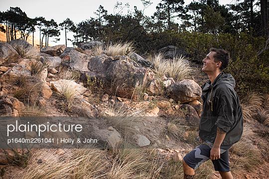 Hiker in rocky landscape - p1640m2261041 by Holly & John