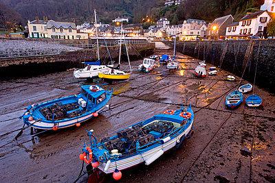 Low tide in Lynmouth Harbour in the evening - p8714121 by Adam Burton