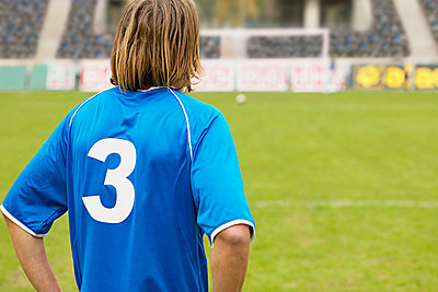 Footballer on the pitch - p92410351f by Image Source