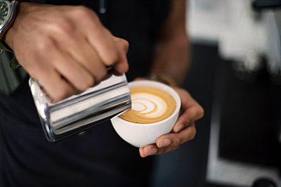 Hand of barista making coffee latte - p947m2176905 by Cristopher Civitillo