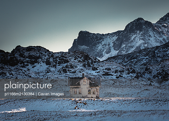 Old House in the Mountains, Lofoten Islands - p1166m2130384 by Cavan Images