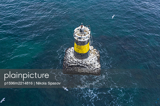 Aerial view of lighthouse in the sea - p1596m2214816 by Nikola Spasov