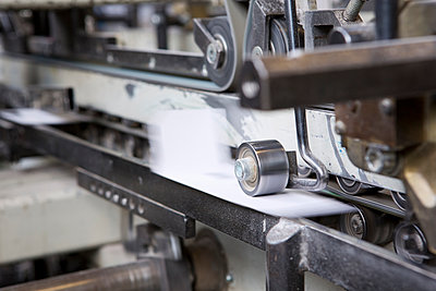 Close up of machine in cardboard factory - p429m942788f by Judith Haeusler