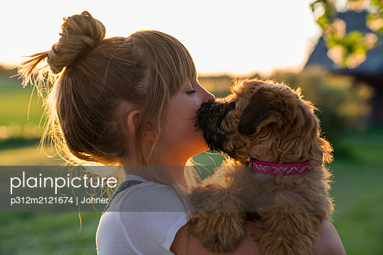 Girl holding dog - p312m2121674 by Johner