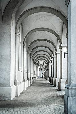 Person walking in the arcades - p1170m2081706 by Bjanka Kadic