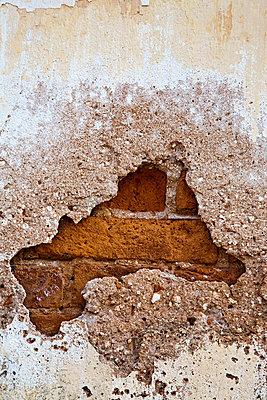 Broken brick wall - p9246741f by Image Source