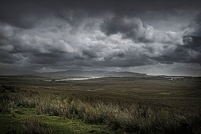 Storm clouds over rural landscape - p555m1454222 by Chris Clor