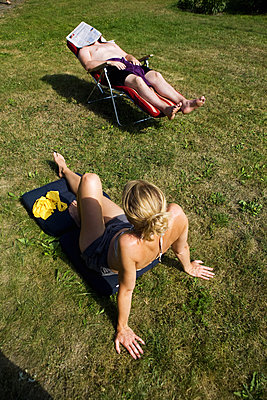 Sunbathing in park  - p972m1088581 by Berno Hjälmrud