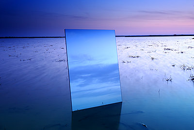 Reflection on a large crystal during the twilight in the natural park of Las Lagunas de Villafafila. zamora. Spain - p1166m2123970 by Cavan Images