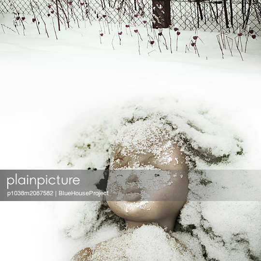 Doll in snow - p1038m2087582 by BlueHouseProject