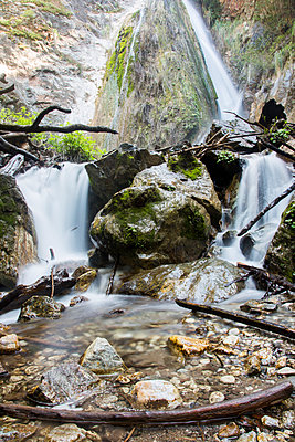 Waterfall on rocks - p555m1482031 by Adam Hester