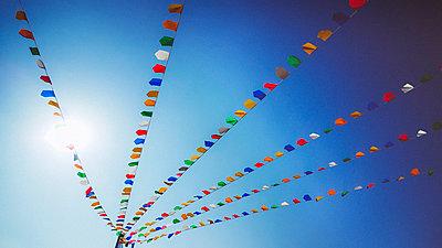 Multicoloured flags  - p813m1332328 by B.Jaubert