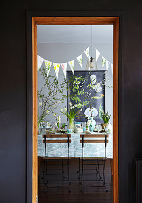 Easter Table setting through doorway with spring flowers - p349m2167870 by Sussie Bell