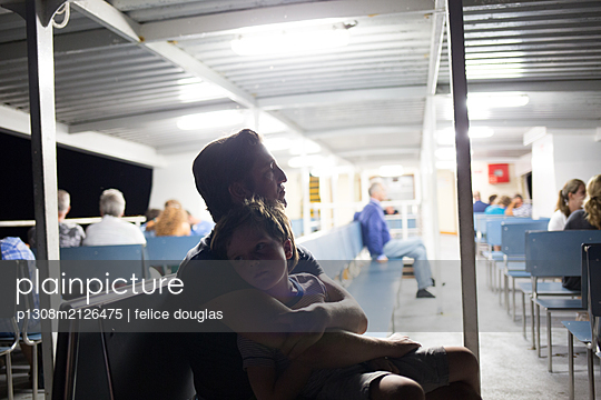 Father and son on ferry - p1308m2126475 by felice douglas