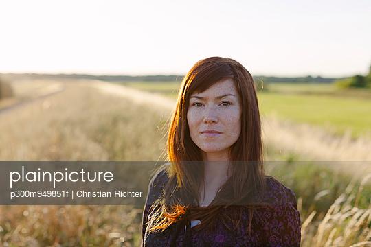 Portrait of brunette woman in a field