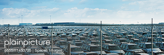 Cars parked in large parking lot