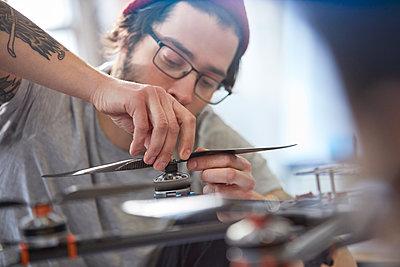Male designer assembling drone - p1023m1486420 by Rafal Rodzoch
