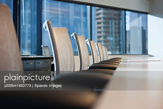 Table and chairs in urban conference room