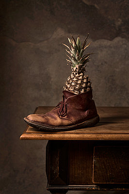 Pineapple placed in shoe - p947m2178580 by Cristopher Civitillo