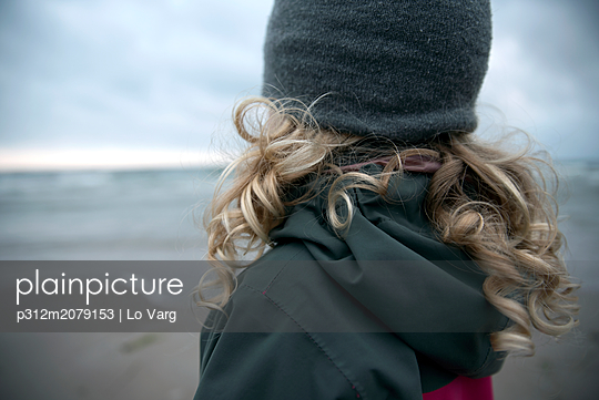 Girl on beach - p312m2079153 by Lo Varg