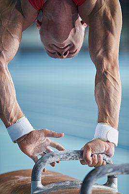 Male gymnast upside-down on pommel horse - p1023m1217717 by Chris Ryan