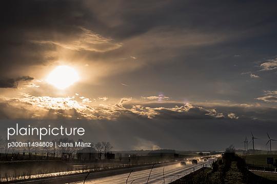Stormy atmosphere over motorway at evening twilight - p300m1494809 by Jana Mänz