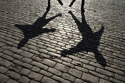Shadow of people on cobblestone - p30020957f by Martin Rügner