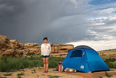 Woman alongside tent - p1291m2026948 by Marcus Bastel