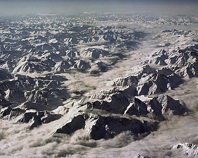 Snowy mountains from airplane - p1409m1467131 by margaret dearing