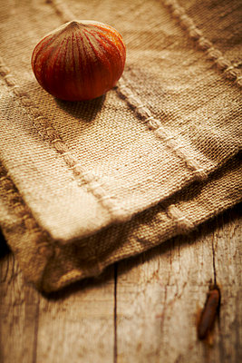 Hazelnut on a napkin - p968m658843 by roberto pastrovicchio