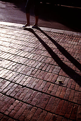 Legs on the pavement and its shadows - p7780007 by Denis Dalmasso